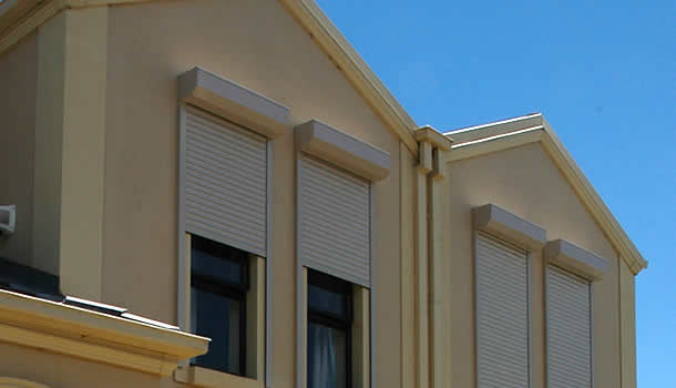 Roller shutters on rendered wall